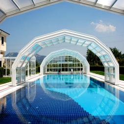 Retractable pool enclosures
