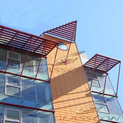 Terracotta Façade with Ceramic Clay Tiles & Solar Shades