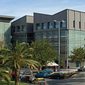 Business Center with Zinc Cladding & Motorized Glass Louvers