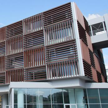 Custom made solar shading solution with motorized aluminium louvers