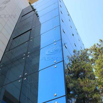 Marble Cladding & Illuminated Structural Glass Façade