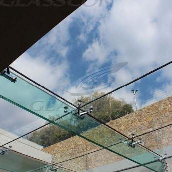 Suspended structural glass ROOF/CANOPY/ATRIUM on horizontal GLASS FINS/BEAMS above a swimming pool with movable folding glass doors from DORMA. ( ca. 90 sqm) - 1