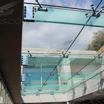 Suspended structural glass ROOF/CANOPY/ATRIUM on horizontal GLASS FINS/BEAMS above a swimming pool with movable folding glass doors from DORMA. ( ca. 90 sqm) - 2