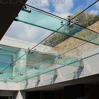 Suspended structural glass ROOF/CANOPY/ATRIUM on horizontal GLASS FINS/BEAMS above a swimming pool with movable folding glass doors from DORMA. ( ca. 90 sqm) - 3