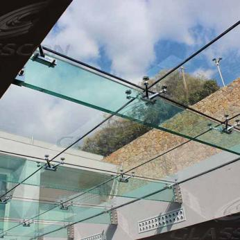 Suspended structural glass ROOF/CANOPY/ATRIUM on horizontal GLASS FINS/BEAMS above a swimming pool with movable folding glass doors from DORMA. ( ca. 90 sqm) - 4