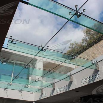 Suspended structural glass ROOF/CANOPY/ATRIUM on horizontal GLASS FINS/BEAMS above a swimming pool with movable folding glass doors from DORMA. ( ca. 90 sqm) - 5