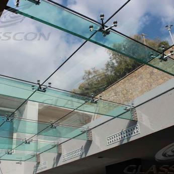 Suspended structural glass ROOF/CANOPY/ATRIUM on horizontal GLASS FINS/BEAMS above a swimming pool with movable folding glass doors from DORMA. ( ca. 90 sqm) - 9