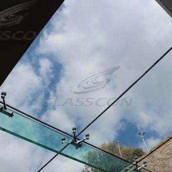Suspended structural glass ROOF/CANOPY/ATRIUM on horizontal GLASS FINS/BEAMS above a swimming pool with movable folding glass doors from DORMA. ( ca. 90 sqm) - 10
