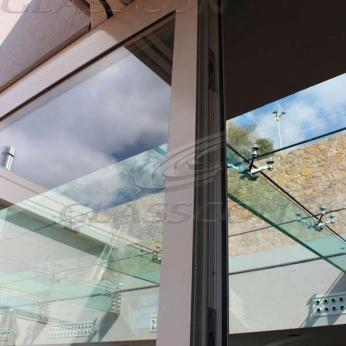 Suspended structural glass ROOF/CANOPY/ATRIUM on horizontal GLASS FINS/BEAMS above a swimming pool with movable folding glass doors from DORMA. ( ca. 90 sqm) - 12