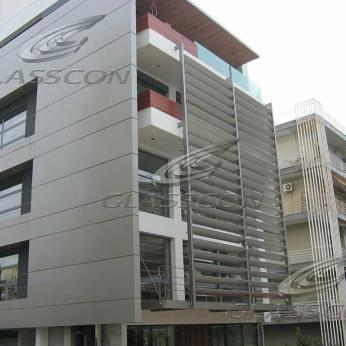 Facade with Motorized Aluminum Louvers & HPL Cladding