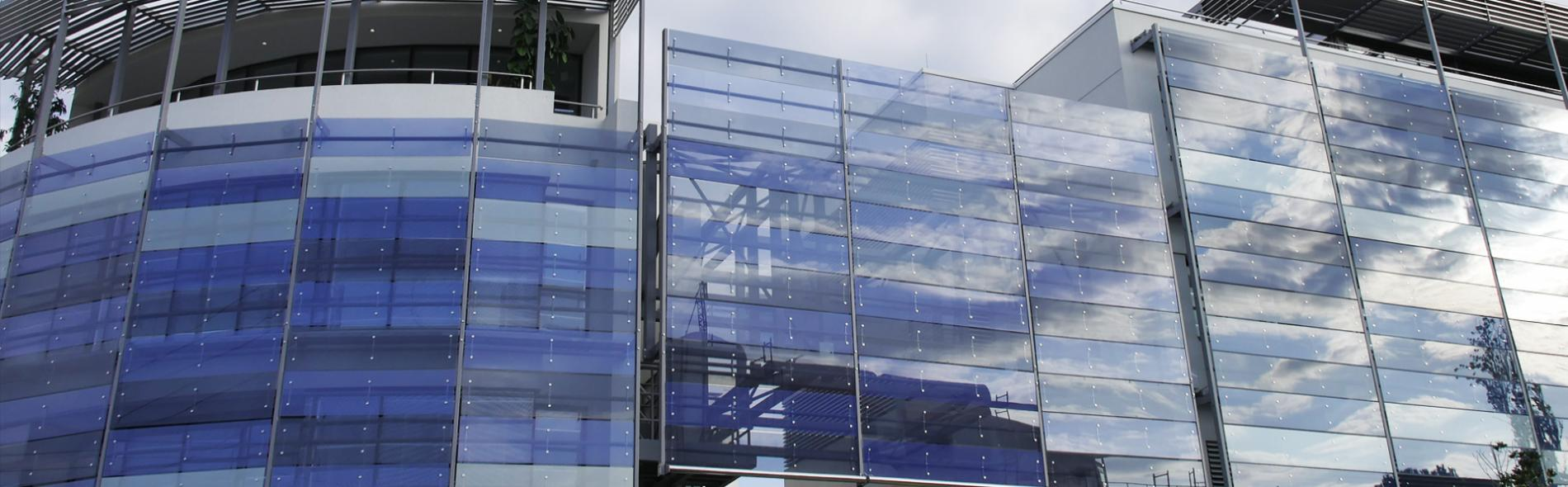 Motorized Glass Louvers - Architectural Solar Shading - Bespoke Facades